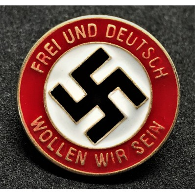 Badge We Wish to be Free and German